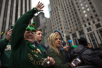 A reveller waves to the crowd on Fifth Avenue during the 252nd annual St. Patrick's Day Parade in New York City. Photo by Eduardo Munoz Alvarez / VIEWpress.