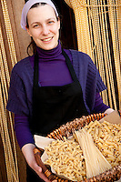 Annalisa Di Matteo displays various pastas, organically produced by 'Libera Terra' Cooperatives at agriturismo 'Portella della Ginestra', near Palermo, Sicily, Italy
