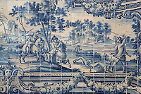 Hunting scene, with men on horseback hunting a deer, traditional blue and white azulejos tile scene, 18th century, part of a series depicting the history of the monastery and the Siege of Lisbon in 1147, in the Monastery of Sao Vicente de Fora, an Augustinian order monastery and church built in the 17th century in Mannerist style, Lisbon, Portugal. The monastery also contains the royal pantheon of the Braganza monarchs of Portugal. Picture by Manuel Cohen
