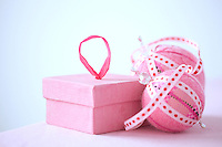 A close up of pink Christmas decorations and a small pink box
