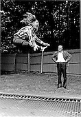 &quot;This is how its done, Dad&quot; yells Susan Ford, left, to her father, United States President Gerald R. Ford, right, as she bounces high into the air off a trampoline at Camp David near Thurmont, Maryland on September 2, 1974.<br /> Mandatory Credit: David Hume Kennerly / White House via CNP