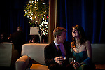 "Jason Green, left, and Anna Hoover relax in the ""Special Guests"" area at the Inaugural Ball, January 21, 2013 in Washington, D.C."