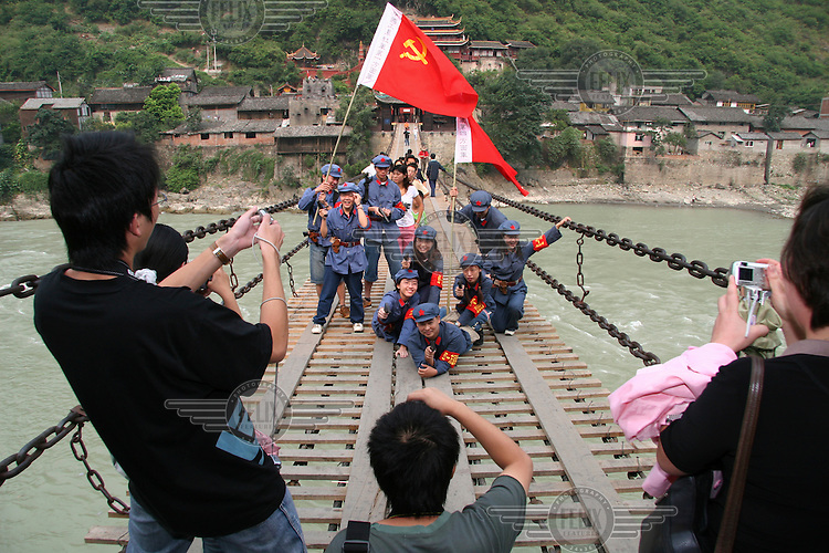 A group of students dressed up as Long Marchers pose for a picture on the Luding bridge.