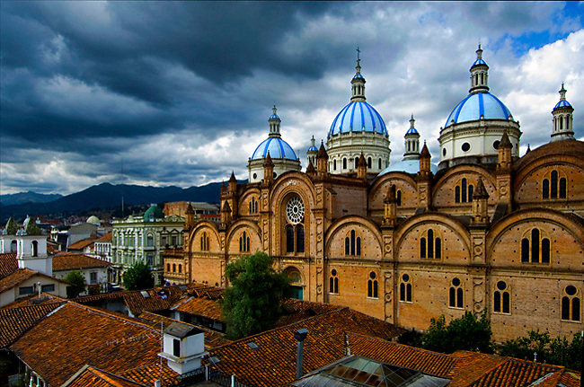 Dramatic Andean sky outlines the sky blue domes of the Cathedral of the Immaculate Conception in Cuenca, Ecuador.  The city center is listed as a UNESCO World Heritage Trust Site.