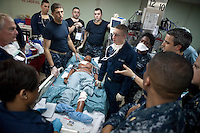 Doctors in the intensive care unit (ICU) on board the USNS Comfort, a naval hospital ship, run a drill with fake patients to prepare for arrival in Haiti to help survivors of the earthquake on Tuesday, January 19, 2010 in the Caribbean Sea.