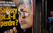 Paris, France.May 1, 2007..Anti-Sarkozy stickers on a magazine cover at a kiosk in Paris for the French Elections set for May 6.
