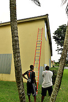 MIRAMAR, FL - OCTOBER 06: Miramar homeowners put up shutters in preparation of Hurricane Matthew in the Monarch Lakes neighborhood of Miramar, Florida October 6, 2016 in Miramar, Florida. The hurricane is expected to make landfall sometime this evening or early in the morning as a possible category 4 storm. Some three million people on the US southeast coast faced an urgent evacuation order. Credit: MPI10 / MediaPunch