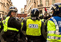 Police officer - 2011<br /> <br /> London, 26/03/2011. The 2011 anti-cuts protest in London organised by the TUC (Trade Union Congress) saw around 500,000 people gather and march in central London. The march was called against the spending cuts being made by the Coalition Government (Conservative party and Liberal Democrats party). The main rally started from Victoria Embankment, and marched through Parliament Square and Whitehall, before terminating in Hyde Park. However, during the day splinter groups of protesters staged direct actions at shops such as Fortum &amp; Mason, and several banks. Police forces heavily armed with riot control equipment tried to contain the crowds and several times used the kettling tactic. The West End first (Soho, Oxford Circus, Piccadilly Road, Piccadilly Circus, and nearby locations), then Trafalgar Square later in the evening, were the main locations of clashes between police officers and protesters.  The day of protests ended with 201 people arrested and more than 60 injured.