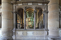 Tomb of Saint Remi, in the chancel of the Basilique Saint Remi or Abbey of St Remi, 11th century, Romanesque, Reims, France. The tomb of Archbishop Saint Remi, 440-533, who converted Clovis, the King of the Franks, to Christianity in 496 AD, is carved with Renaissance statues of the peers of France and surrounded by a 17th century enclosure. The original 16th century tomb was destroyed in the French Revolution and much of this present version dates to 1847. The abbey is a UNESCO World Heritage Site. Picture by Manuel Cohen