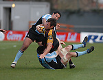Dragons Joe Bearman is brought down by Glasgows John Beattie and Daryl Gibson Newport Gwent Dragons Vs Glasgow Warriors Magners League  Copyright IJC Photography Photographer Ian Cook
