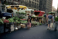 Vegetables on sale at farmers' stands in the Union Square Greenmarket in New York on in June 1981. (© Frances M. Roberts)