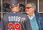 1 April 2013: Miami Marlins Owner and CEO Jeffrey Loria chats in the dugout with infielder Greg Dobbs prior to the Opening Day Game between the Miami Marlins and the Washington Nationals at Nationals Park in Washington, DC. The Nationals shut out the Marlins 2-0 to launch the 2013 season. Mandatory Credit: Ed Wolfstein Photo *** RAW (NEF) Image File Available ***