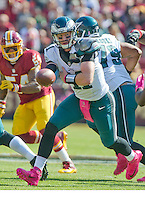 Philadelphia Eagles quarterback Carson Wentz (11) looks to hand off the ball early in the first quarter against the Washington Redskins at FedEx Field in Landover, Maryland on Sunday, October 16, 2016.<br /> Credit: Ron Sachs / CNP /MediaPunch