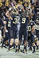 Annapolis, MD - December 27, 2016: Wake Forest Demon Deacons running back Cade Carney (36) and Wake Forest Demon Deacons wide receiver Chuck Wade (9) celebrates during game between Temple and Wake Forest at  Navy-Marine Corps Memorial Stadium in Annapolis, MD.   (Photo by Elliott Brown/Media Images International)