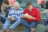 HOT SPRINGS, AR - MARCH 18: Fans studying their programs around the provillion in the infield before the running of the Rebel Stakes at Oaklawn Park on March 18, 2017 in Hot Springs, Arkansas. (Photo by Justin Manning/Eclipse Sportswire/Getty Images)