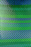 A detail of a blue and green chevron patterned fabric covering.