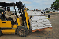 job #40242. 5/11/11 Clarksdale -- Vicksburg, MS, U.S.A. -- Employees of Ergon Marine and Industrial supply despartately fill  sand bags try to sand bag their property from the over flow of the MS River. Vicksburg, a riverfront town steeped in war and sacrifice, gets set to battle an age-old companion: the Mississippi River. The city that fell to Ulysses S. Grant and the Union Army after a painful siege in 1863 is marshaling a modern flood-control arsenal to keep the swollen Mississippi from overwhelming its defenses. --Photo©SuziAltman.com...Photo by Suzi Altman, Freelance.