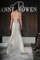 Model walks runway in a Harry Winston wedding dress by Anne Bowen, for the Anne Bowen Bridal Spring 2012 runway show.