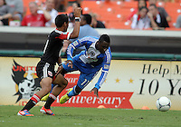 WASHINGTON, D.C. - AUGUST 19, 2012:  Andy Najar (14) of DC United knocks Freddy Adu (11) of the Philadelphia Union off the ball during an MLS match at RFK Stadium, in Washington DC, on August 19. The game ended in a 1-1 tie.