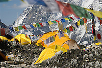 Everest base camp is a little city at the base of the Khumbu icefall with cooking tents, sleeping tents, medical tents, and toilet tents all draped in prayer flags and the flags of a dozen countries. It is the temporary home to countless dreams.
