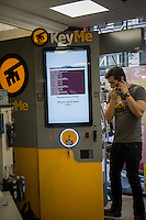 A technician for KeMe installs a self-service key storage and duplication kiosk in a 7-Eleven store in New York on Friday, June 28, 2013. The kiosks store an encrypted secure digital copy of your key and in the event that you get locked out can manufacture your key within the machine using your fingerprint as identification (which you stored with the file of your key) The company is installing five kiosks in New York and they can also duplicate keys.(© Richard B. Levine)