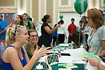 Brookelyn Schaller, a freshman studying business, stops to chat at the Student Now Alumni Assocation during the Multicultural Student Expo and Involvement Fair. Photo by Olivia Wallace