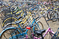 Bicycles lined up outside a school in Xingping, China