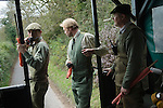 Game Bird shoot St Claire's Estate, Hampshire. England 2007. Estate Keepers and beater in wagon dropping off beaters.