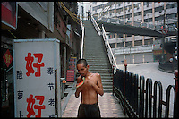 """Wanzhou, China, August 2003.Many old or ressourceless people fall """"through the net"""" and become homeless as thousands of buildings are destroyed along 700 km of the Yangtze Kiang river because of the 3 Gorges Dam project.."""