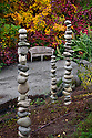 WA08870-00..WASHINGTON - Stacks of rocks in the Perennial Border Garden area of the Bellevue Botanical Garden.
