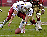 Arizona Cardinals quarterback Jake Plummer (16) recovers fumbled ball on Sunday, October 27, 2002, in San Francisco, California. The 49ers defeated the Cardinals 38-28.