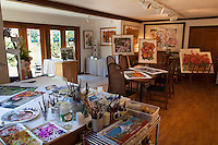 Sally Robertson's Bolinas, California studio with her watercolor paintings