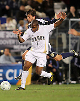 Darlington Naqbe #6 of the University of Akron shields the ball from Adam Shaw #5 of the University of Michigan during the 2010 College Cup semi-final at Harder Stadium, on December 10 2010, in Santa Barbara, California.Akron won 2-1.