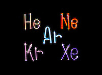 NOBLE GAS DISCHARGE TUBES - ELEMENTAL SYMBOLS<br /> Helium, Neon, Argon, Krypton, &amp; Xenon<br /> Atoms of the gases emit photons of  their characteristic spectral color when excited by the flow of electrons in discharge tubes, (here shown as blown glass in the shape of  the element's symbol).
