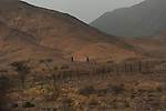 Egyptian soldiers patrol Israel-Egypt border.