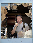 Jacob Norring, a member of a DanChurchAid humanitarian mine action team, communicates with a radio in a building along war-ravaged Tripoli Street in Misrata, Libya. DanChurchAid is a member of the ACT Alliance, and the team is in Misrata to help local residents deal with unexploded ordnance that poses a significant threat to the civilian population.
