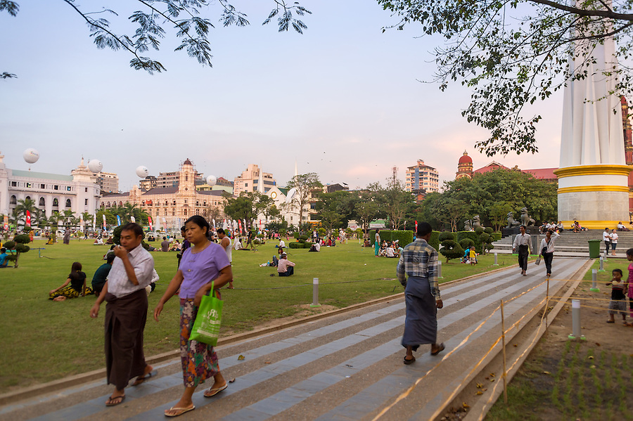 YANGON, MYANMAR - CIRCA DECEMBER 2013: People walking in the Maha Bandoola Garden in Yangon.