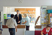 Chatting in the staffroom,  State Secondary Roman Catholic school.