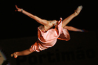 Kimberly Mason of Australia split leaps during gala exhibition at 2006 Portimao World Cup of Rhythmic Gymnastics on September 10, 2006 at Portimao, Portugal.  (Photo by Tom Theobald)