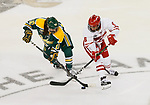 ST CHARLES, MO - MARCH 19:  Michaela Pejzlová (10) of the Clarkson Golden Knights tries to get by Presley Norby (6) of the Wisconsin Badgers during the Division I Women's Ice Hockey Championship held at The Family Arena on March 19, 2017 in St Charles, Missouri. Clarkson defeated Wisconsin 3-0 to win the national championship. (Photo by Mark Buckner/NCAA Photos via Getty Images)