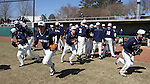 CARY, NC - MARCH 05: Notre Dame players race to their positions for the start of the game. The Monmouth University Hawks played the University of Notre Dame Fighting Irish on March 5, 2017, at USA Baseball NTC Field 2 in Cary, NC in a Division I College Baseball game, and part of the Irish Classic tournament. Notre Dame won the game 4-0.