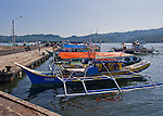 Fishing boats throng the landing at the main fish market in Bitung, North Sulawesi, Indonesia.