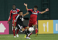 WASHINGTON, DC. - AUGUST 22, 2012:  Dwayne DeRosario (7) of DC United sends over a cross past  Pavel Pardo (17) of the Chicago Fire during an MLS match at RFK Stadium, in Washington DC,  on August 22. United won 4-2.