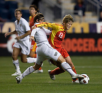Amy LePeilbet (6) of the USWNT tackles the ball away from Ma Jun (13) of China during an international friendly at PPL Park in Chester, PA.  The U.S. tied China, 1-1.