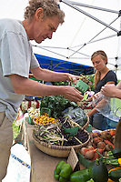 Chef Andrew Milne-Allan selects fresh, local produce at the Sorauren farmers market.