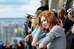 Sad girl among tourists on Eiffel Tower. Loneliness, misunderstanding