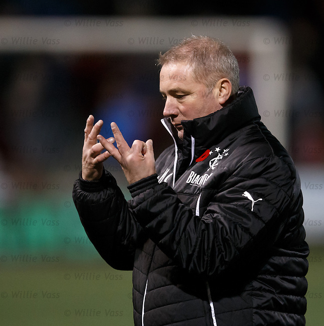 Ally McCoist walking off at full time stretching his frozen fingers