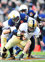 Army's Trent Steelman is tackled for a loss. Navy Midshipmen defeated Army Black Knights 27-21 during the Army vs. Navy game at the FedEx field in Landover, MD on Saturday, December 10, 2011. Alan P. Santos/DC Sports Box