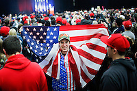 BETHPAGE, NY - APRIL 6 : Supporters of U.S. Republican presidential candidate Donald Trump listen to him during a rally on April 6, 2016 in Bethpage, New York. Front-running Republican candidate Trump will address supporters on the heels of a potentially damaging loss in the Wisconsin primary. Photo by VIEWpress