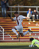 Virginia Tech midfielder Niels Kirch (10) drive for the net thwarted.Boston College (maroon) defeated Virginia Tech (Virginia Polytechnic Institute and State University) (white), 3-1, at Newton Campus Field, on November 3, 2013.